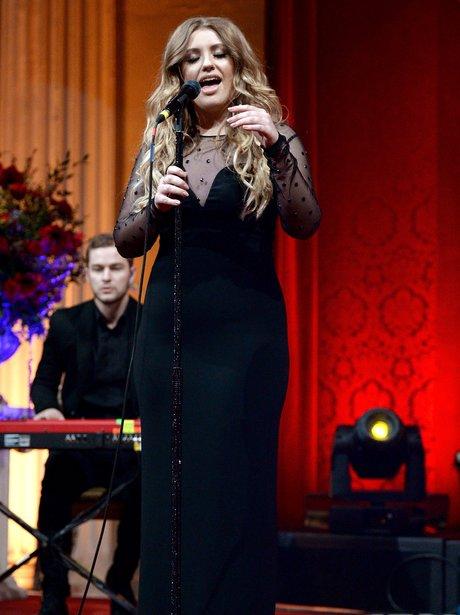 Ella Henderson wearing a long black dress
