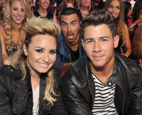 Nick Jonas and Demi Lovato Photobomb