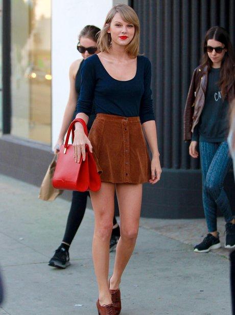 Taylor Swift wearing a short skirt