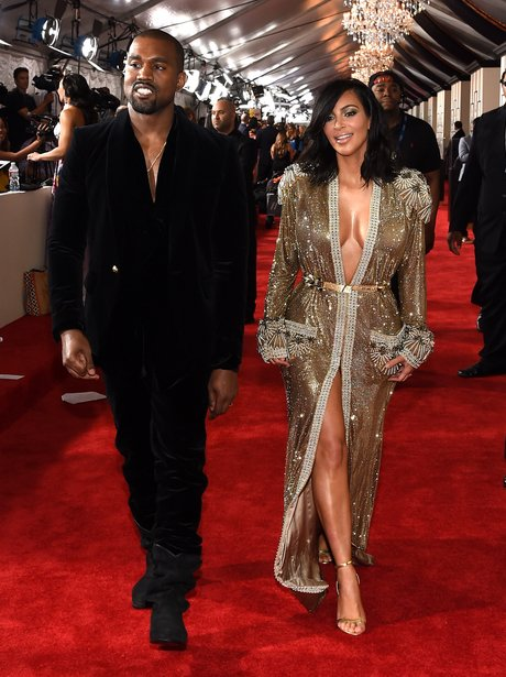 Kanye West and Kim Kasdashian arrive at the Grammy