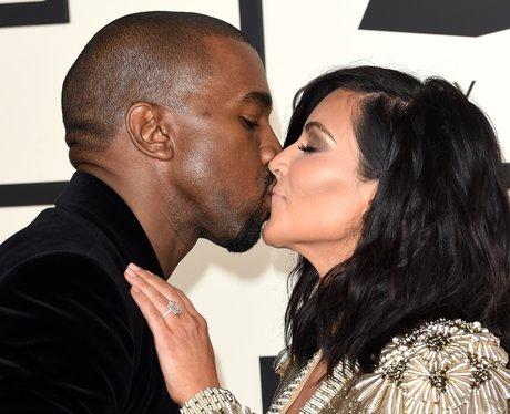 Kanye West and Kim Kasdashian kiss