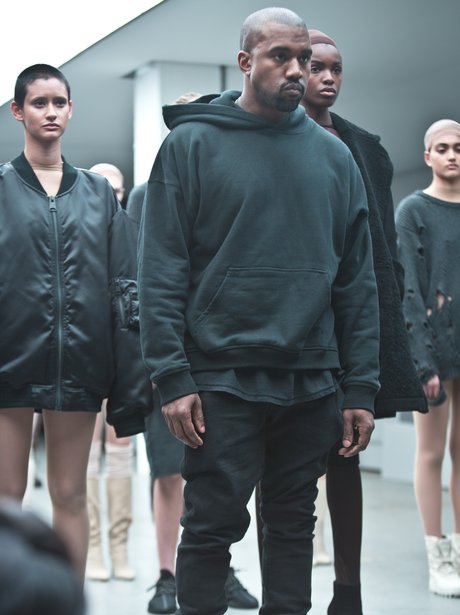 36e5099fa69 Kanye West poses alongside models at the launch of his new Yeezy Boost  range of trainers for Adidas.