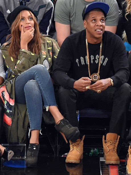 Beyonce and Jay Z watching the basketball