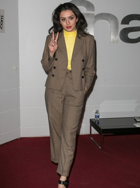 Charli XCX wearing a suit