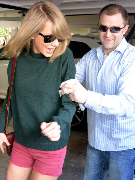 Taylor Swift with her boyguard