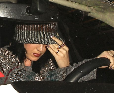Katy Perry in a beanie driving