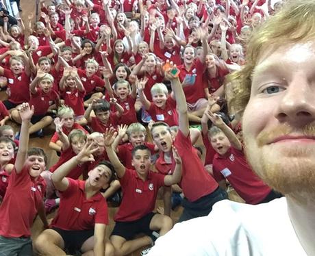 Ed Sheeran sings to school kids