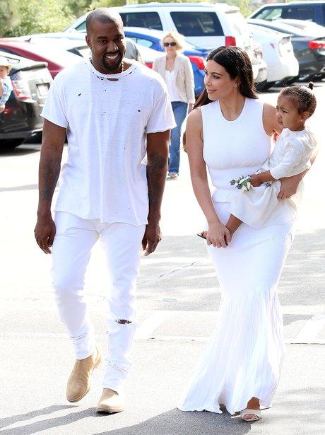 Kanye West and Kim Kasdashian with North