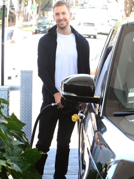 Calvin Harris filling his car with petrol