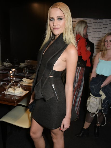 Pixie Lott wearing a black dress at Notion party