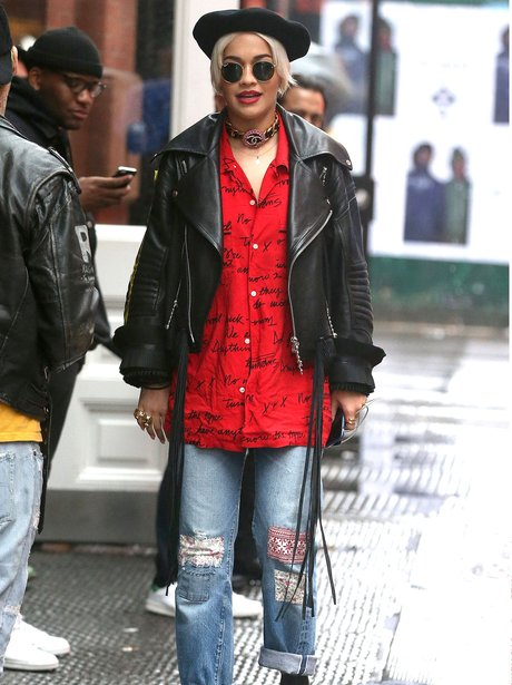 Rita Ora wearing a hat and leather jacket