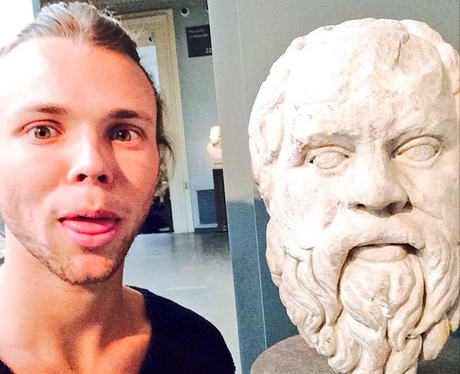 Ashton Irwin with a  Statue