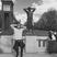 Image 5: Ashton irwin posing by a statue