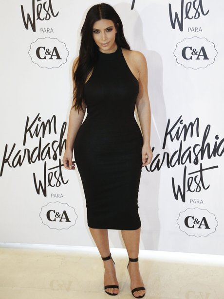 Kim Kardahian wearing a tight black dress