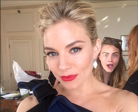Sienna Miller and Cara Delevingne Photobomb