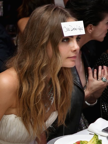 Cara Delevingne with a name tag on her forehead