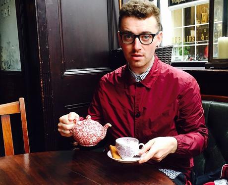 Sam Smith drinking tea