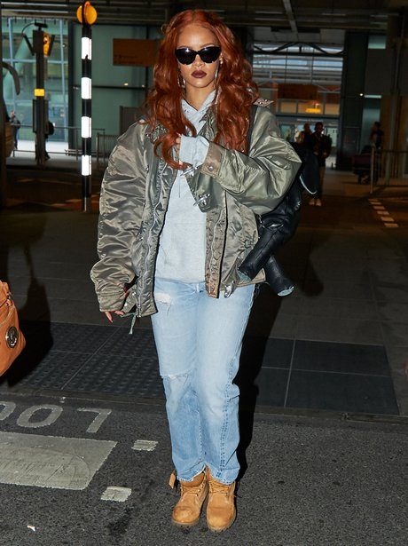 Rihanna wearing jeans at Heathrow airport