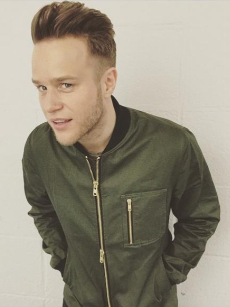 Olly Murs wearing a bomber jacket