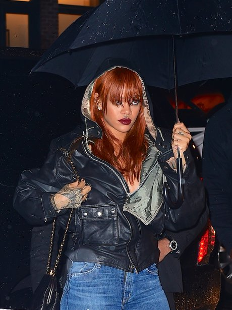 Rihanna carrying an umbrealla