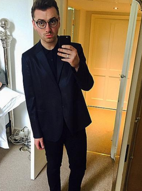Sam Smith wearing a suit