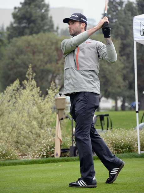 Adam Levine playing golf