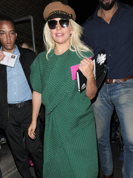 lady gaga covered up in a green outfit