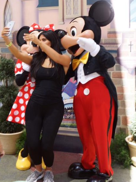 Kim Kardashian taking a selfie with Micky Mouse