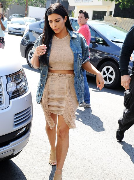 Kim Kardashian pregnant showing off stomach