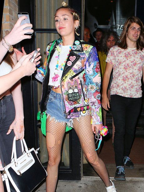 Miley Cyrus wearing a colouful jacket