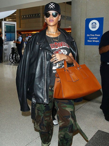Rihanna at LAX wearing camouflage trousers