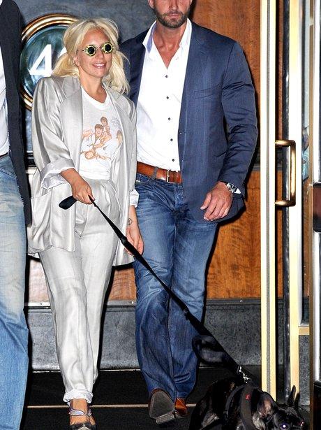 Lady Gaga wearing a grey suit