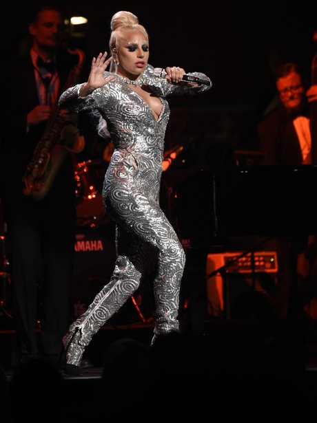 Lady Gaga wearing a silver jumpsuit