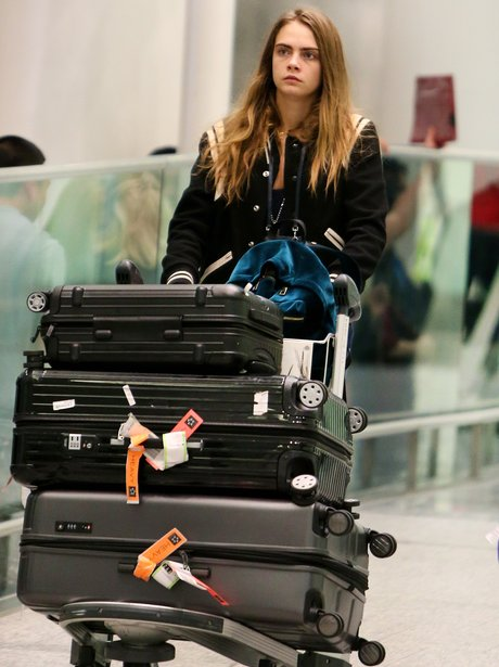 Cara Delevingne Pushing Bags