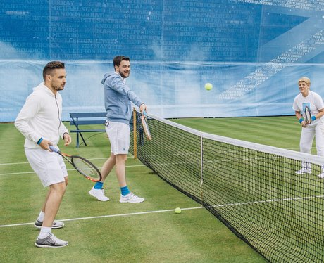 Liam Payne playing tennis