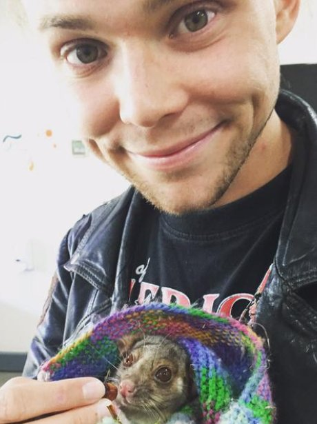 5SOS star Ashton with a possum
