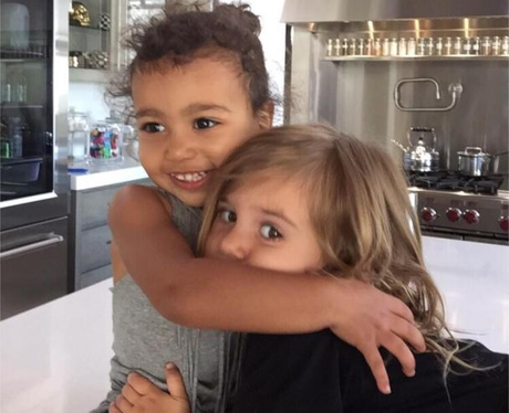 North West cuddling her cousin Penelope Disick