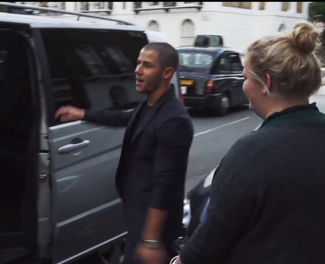 Nick Jonas picks up a fan in car