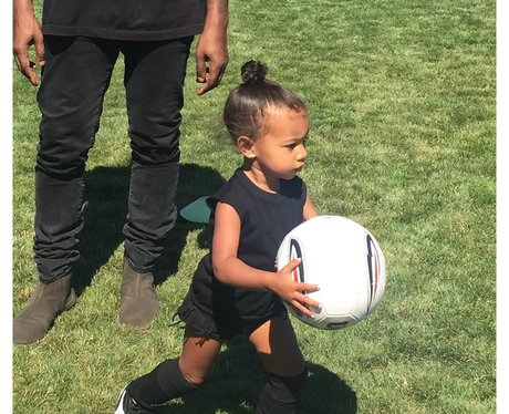 North West playing football with Kanye