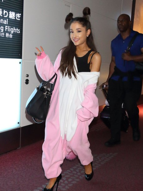Ariana Grande wearing a onesie with heals