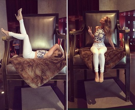 Perrie Edwards in a chair