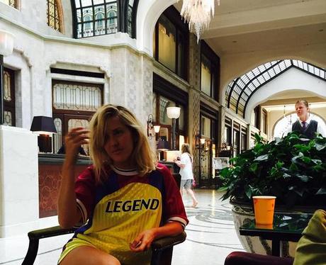 Ellie Goulding wearing a legen t shirt