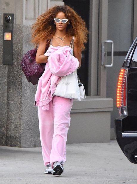 Rihanna wearing a pink tracksuit