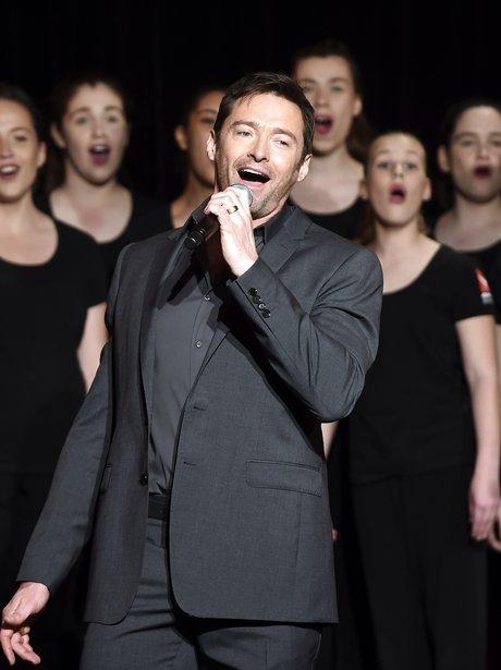 Hugh Jackman sings with the Qantas choir during a