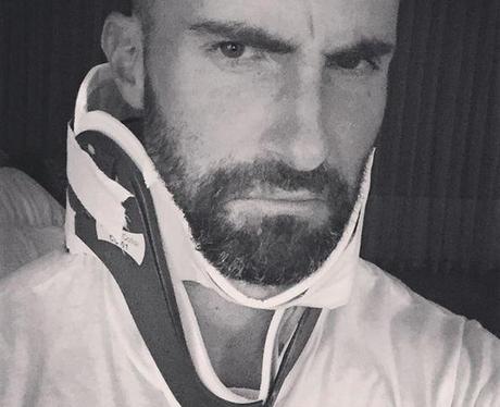Adam Levine in neck brace instagram
