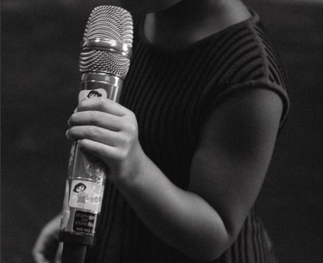 Blue Ivy holding microphone