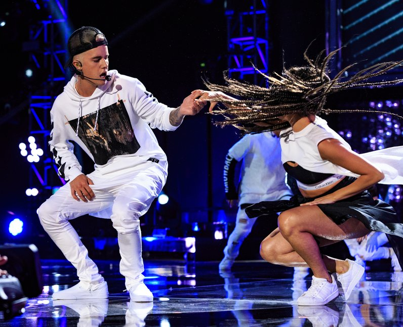 Justin Bieber performs onstage during the Think It