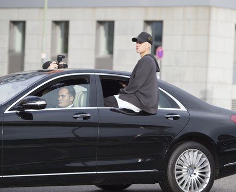 Justin Bieber sitting on car