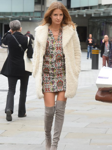 Millie Mackintosh wearing thigh high boots