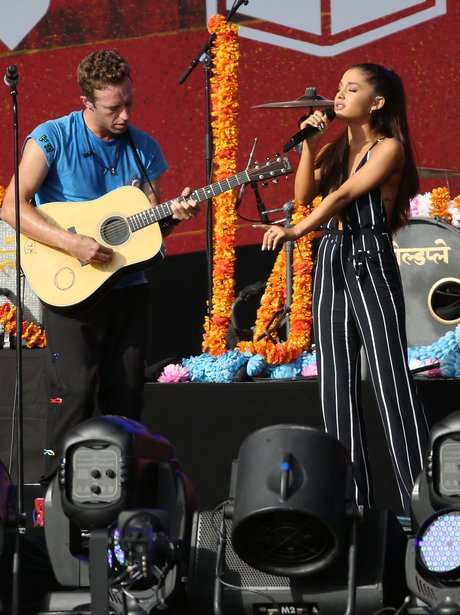 dc797a095e1 Coldplay s Chris Martin and Ariana Grande hit the stage together. The pair  hooked up for a duet at 2015 Global Citizen Festival.